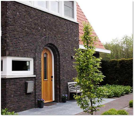 Облицовка фасада дома фото
