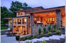 Облицовка фасада дома: как подготовить стены под отделку искусственным камнем