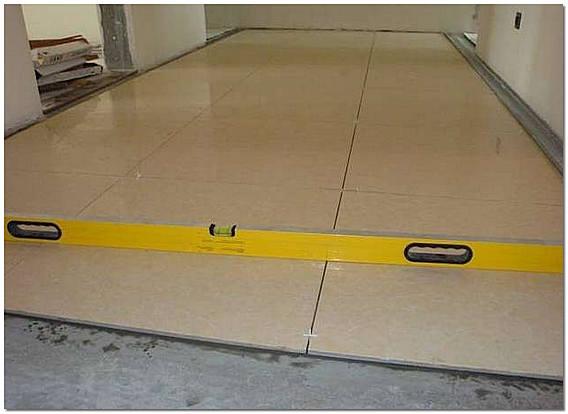 Укладка керамогранита на бетонную стяжку фото