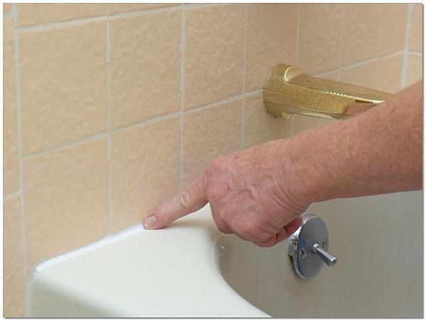 Заделка шва между ванной и стеной силиконом своими руками