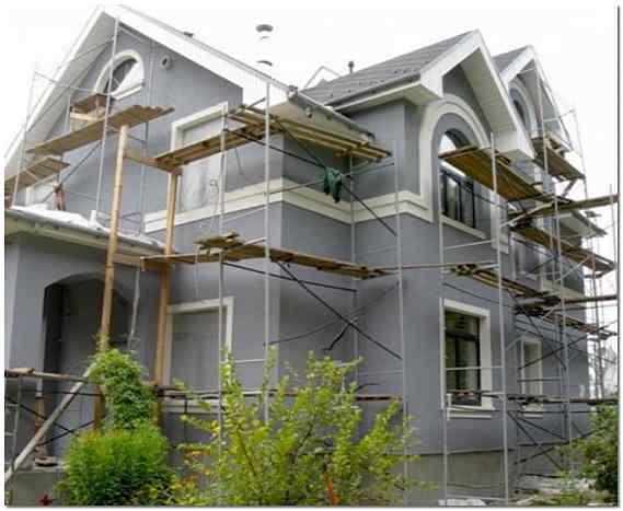 Отделка фасада дома декоративной штукатуркой фото